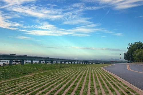 road sky grass pattern sunrays