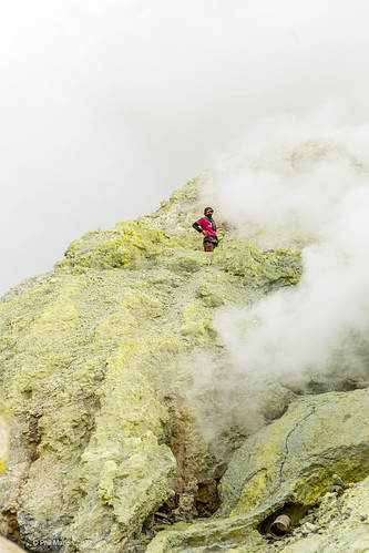 Sulphur miner and noxious sulphur fumes inside crater of Kawah Ijen volcano - Banyuwangi, Java Indonesia | by Phil Marion (173 million views - THANKS)