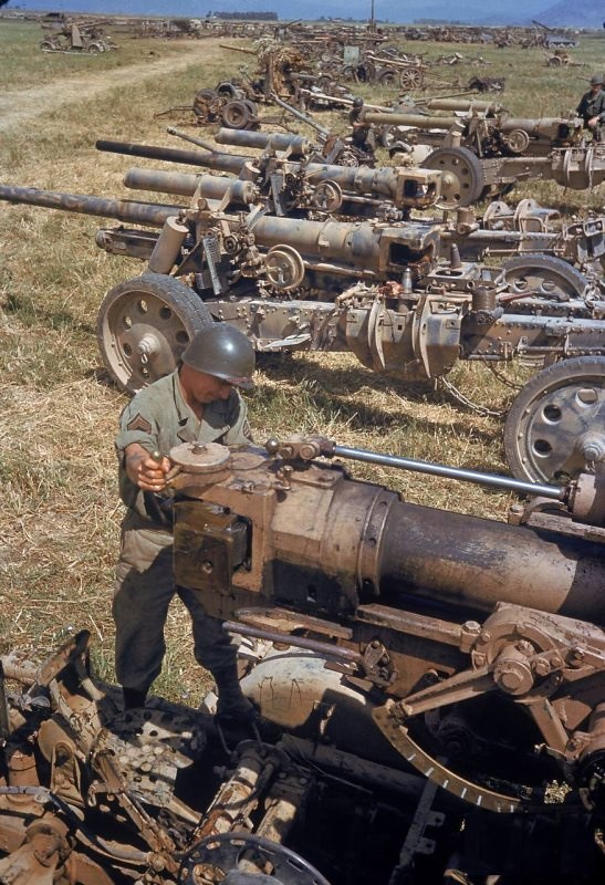 A U.S. soldier looks at the German artillery