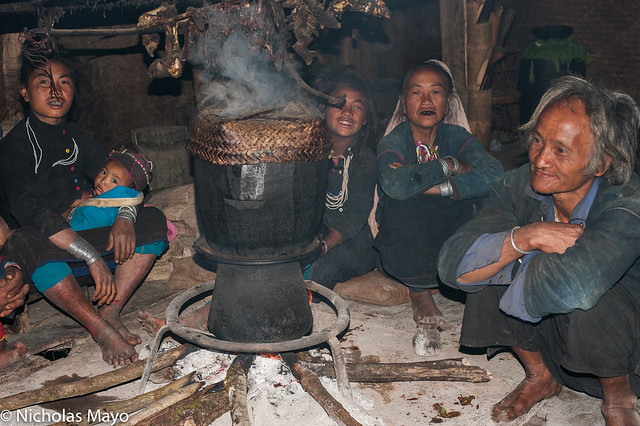 Family Around The Cooking Pot