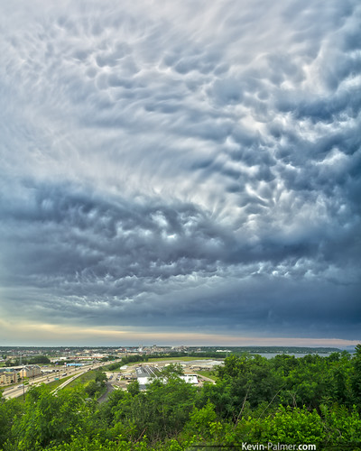 trees summer sky storm green june skyline clouds squall dark illinois afternoon view threatening stormy line freeway thunderstorm interstate peoria bluff anvil mammatus illinoisriver i74 eastpeoria kevinpalmer fondulacdrive pentaxk5 samyang10mmf28