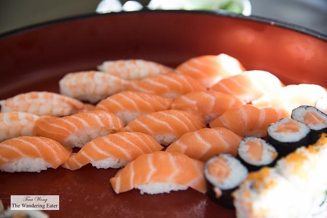 Salmon nigiri, salmon maki rolls, and ebi (shrimp) nigiri