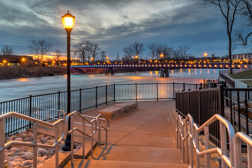 hdr indiana mishawaka nikon nikond5300 stjosephriver bridge clouds evening fence footbridge geotagged lamp lamppost lights longexposure reflection reflections river rocks sky stairs starburst sunset tree trees water unitedstates