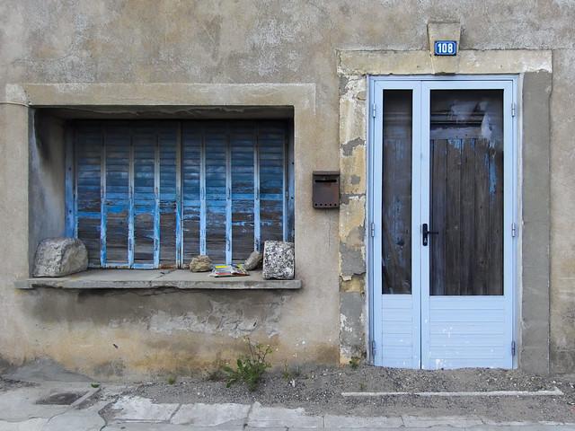 aluminium door in front of a wooden door