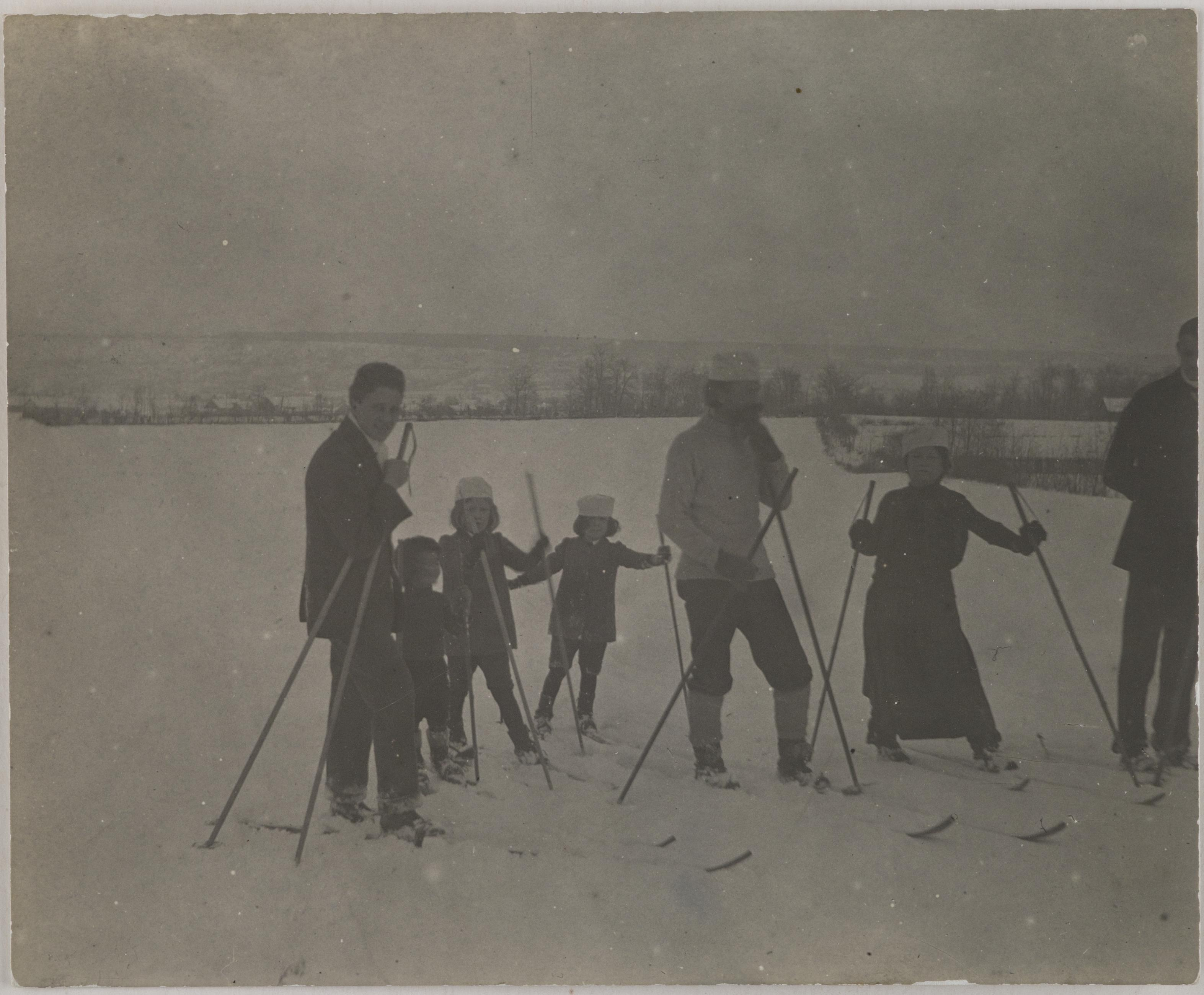Hungarian children and adults skiing on ice.