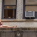 Woman on a Ledge in NYC by EagleEyez