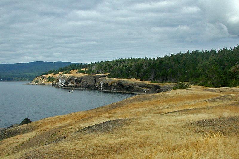 Rolling fields and high bluffs at Helliwell Park, Hornby Island, Gulf Islands, Georgia Strait, British Columbia, Canada
