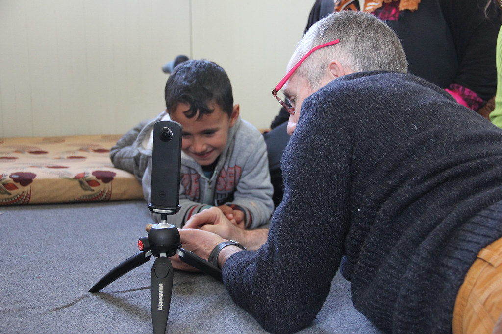 Professor David Coley showing research equipment to a child