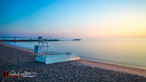 longexposure orange lake water clouds sunrise canon landscape boat lifeguard lifeboat milwaukee wi lakefront mke atwaterbeach leefilter discoverwisconsin travelwisconsin bigstopper 5dmarkiii