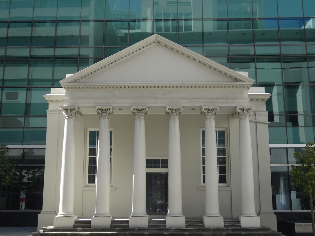 Perth. Old and new. Classical hall preserved in front of a highrise glass building in Hay Street Perth. Doorway from the past into the future.