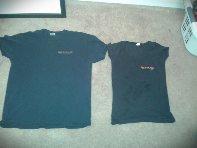 These shirts are the uniform for my work. On the left is what the guys wear and on the right is what the girls wear. The guys get to wear comfortable t shirts while the girls have to wear tight, uncomfortable, and low cut shirts. This shows gender expecta
