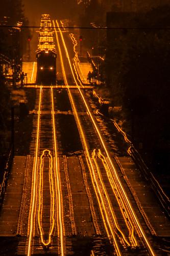 freighttrain unionpacificrailroad uprr genevasubdivision genevaillinois kanecounty chicagoland sunset goldenhour foxriverbridge metrastation downtowngeneva aerial route25bridge transportation nikond5100 tamron18270 glowing rails tracks reedited2018 photoshopbyfehlfarben thanksbinexo