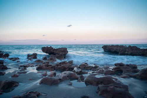 sunset rocks water