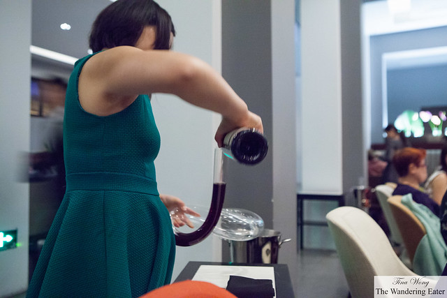Pouring vintage wine into a unique shaped decanter