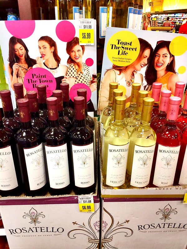 """I saw this at Kroger this morning. It reinforces the gender norm of girls needing to wear makeup to look pretty, and also the notion of drinking """"girly"""" drinks like wine as opposed to something like beer."""