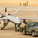 Airmen of the 49th Aircraft Maintenance Squadron tow an MQ-9 remotely piloted aircraft from the flightline to the hangar at Holloman Air Force Base, N.M., Dec. 16, 2016. The squadron supports the 6th Reconnaissance Squadron, as well as the 9th and 29th Attack Squadrons, enabling the graduation of pilots and sensor operators in support of the Air Force's largest formal training unit. (U.S. Air Force photo by J.M. Eddins Jr.)