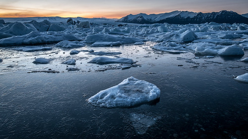 iceland blue landscape sunset travel nature water dusk cold glacier lagoon orange ice easternregion is onsale portfolio