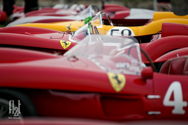 20 Ferrari 250 TR's line the 18th Fairway