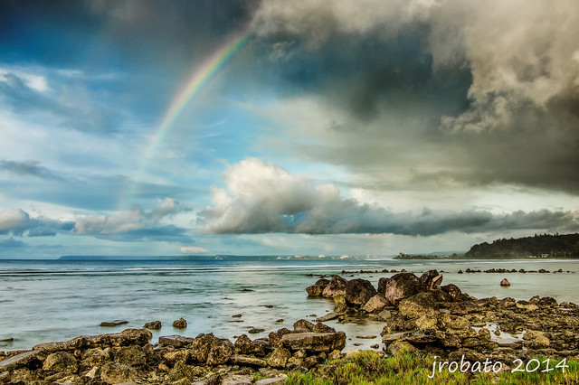 Rainbow Vs Rain Clouds