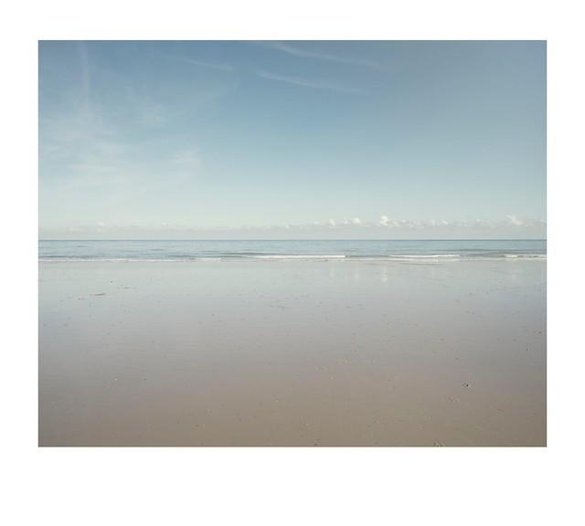 Sand, surf, sea and sky