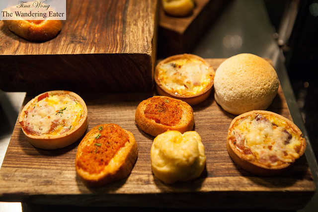 Mini pizzas and pineapple bun filled with Chinese roast pork (the spherical roll)