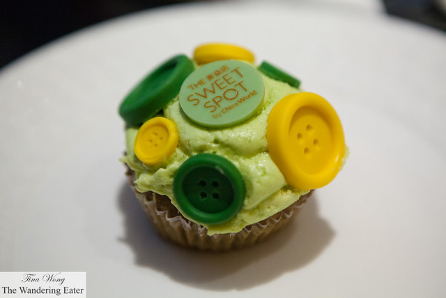Pistachio cupcake covered in marzipan buttons