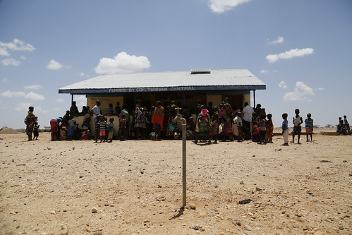 Women and children queue at a health clinic in Kapua, Turkana County, northwest Kenya, 29 January 2017. | by DFID - UK Department for International Development