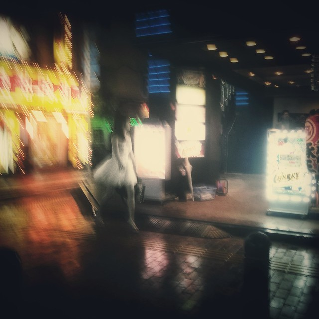A woman, a white dress and the night in Shinjuku