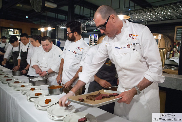 Chef Mark Ladner (front of the line), Chef Luciano Monosillo (center left with the beard) and a bridgade plating their steak dish