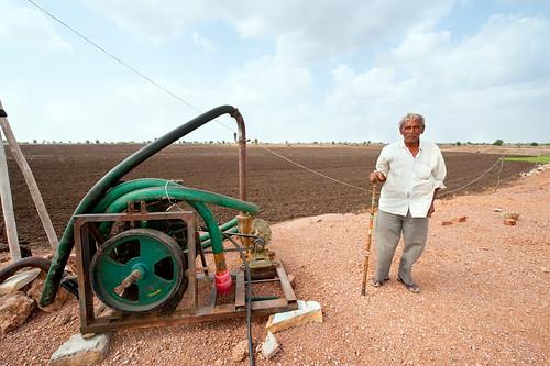 a pump in an empty crop field