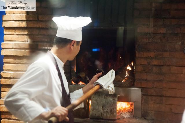 The chef watching the oven full of Peking ducks