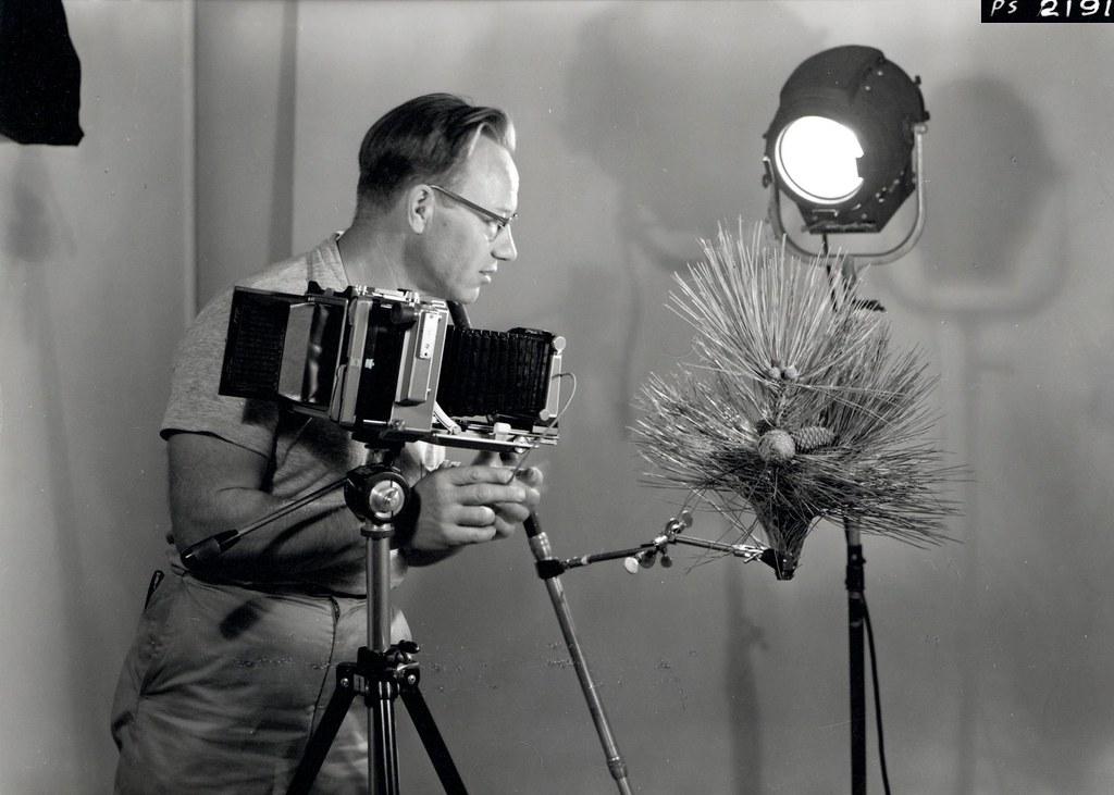 1958  Photographer Wally C  Guy using Linhof Technika came