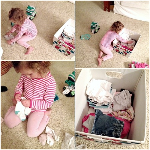 little girl folding laundry