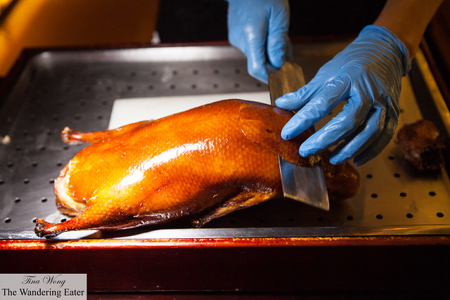 Our Peking duck getting sliced tableside
