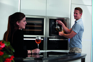 Man pouring a drink from beer dispenser in modern kitchen | by CDAappliances