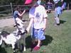 Sam feeds the goats.