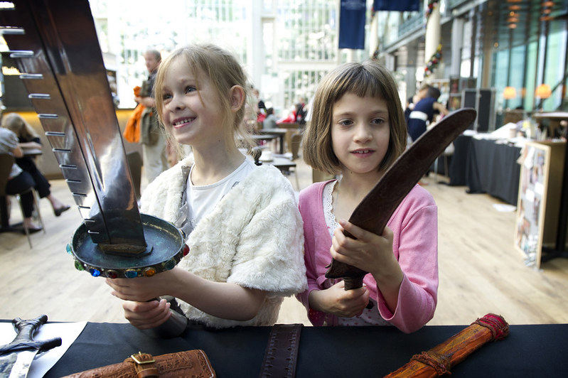 Children exploring Royal Opera House props at a Welcome Performance © ROH. Photo by Sim Canetty-Clarke