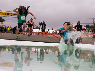 teams entering pool in wife carrying World Championships | by VisitLakeland