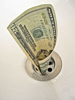 Money down the drain | by Images_of_Money