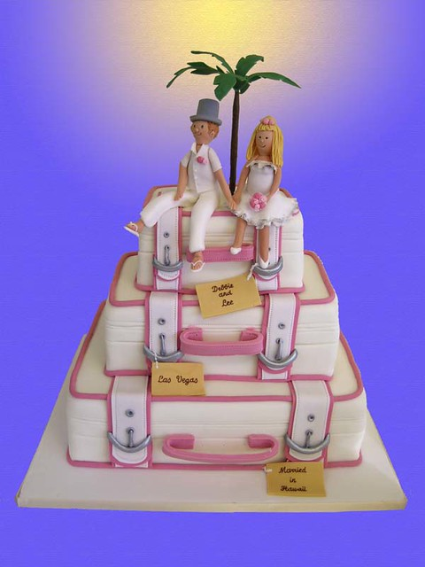 Novelty Suitcase wedding cake with bride and groom topper