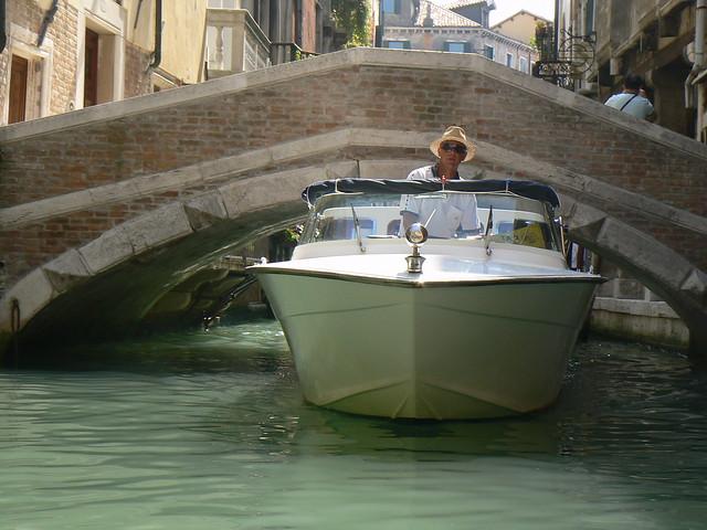 Boat and low bridges, Venice