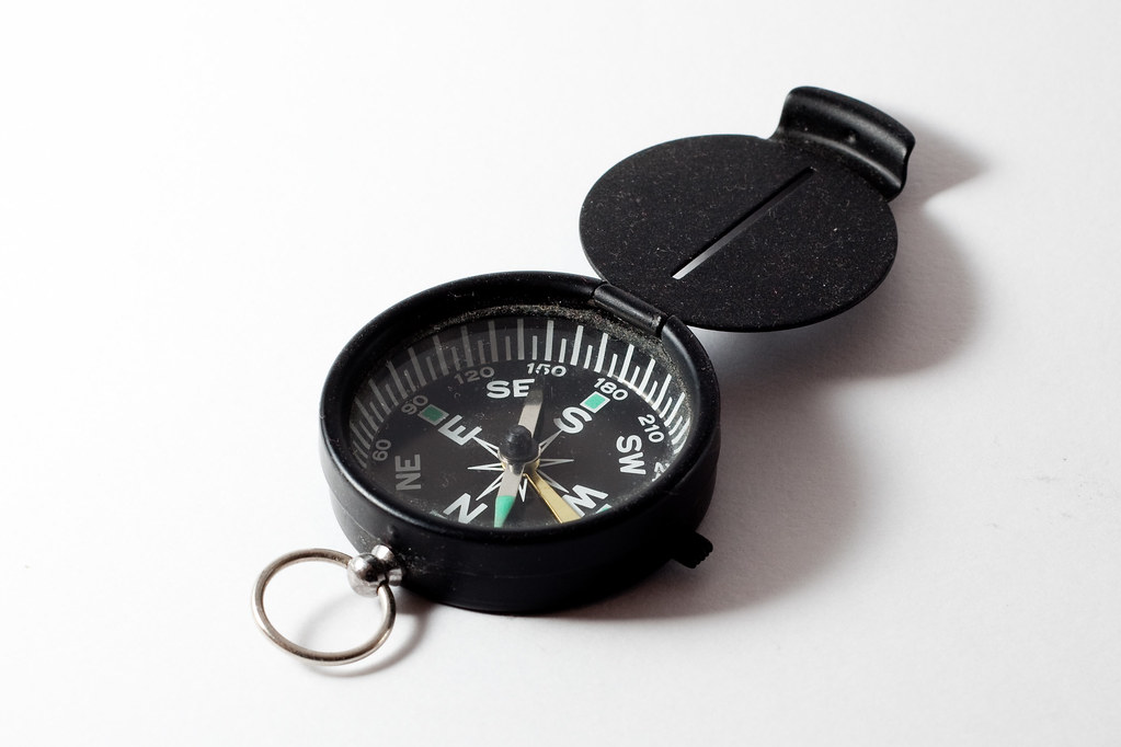 """""""Compass"""" by Matt Biddulph is licensed with CC BY-SA 2.0."""