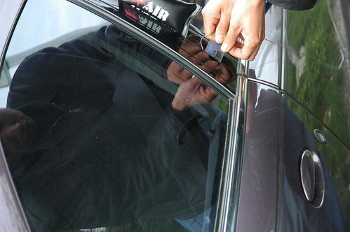 Locksmith breaking into an accidently locked car, Seattle, Washington, USA2399 | by Wonderlane