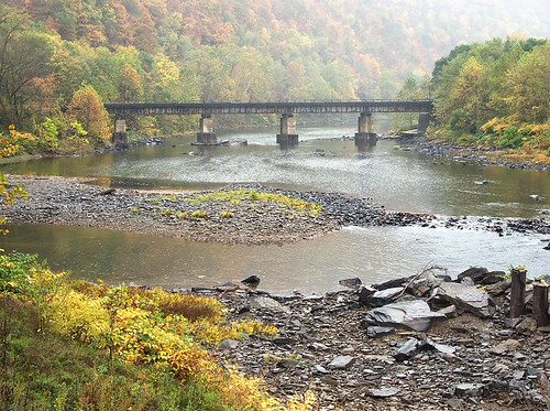 old bridge autumn red usa mountain history fall wet water leaves rain stone vintage river leaf unitedstates decay south overcast historic southern westvirginia bo appalachia allegheny rowlesburg deepsouth baltimoreohio pbble