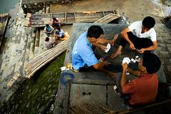 Riverside gambling - Yangshuo, China | by Szymon Kochanski