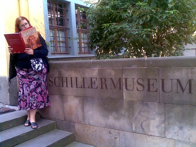 Reading Schiller comic in front of Schiller museum
