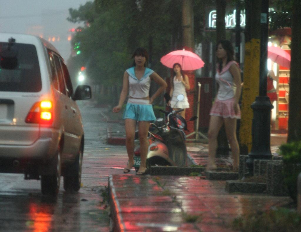 Betelnut girls work even in typhoon - a photo on Flickriver