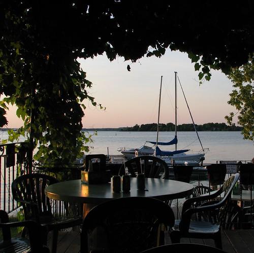 sunset ontario canada sailboat table restaurant boat interestingness dock chairs explore kingston thousandislands lakeontario stlawrenceriver wolfeisland islandgrill cans2s coveredpatio ivypatio i500aug232008486