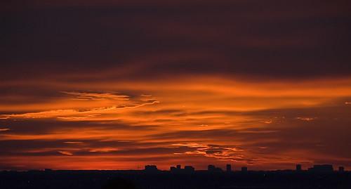 red summer orange silhouette clouds sunrise dawn colorado warm crane denver littleton denvertechcenter nikkor18200mmf3556gifed