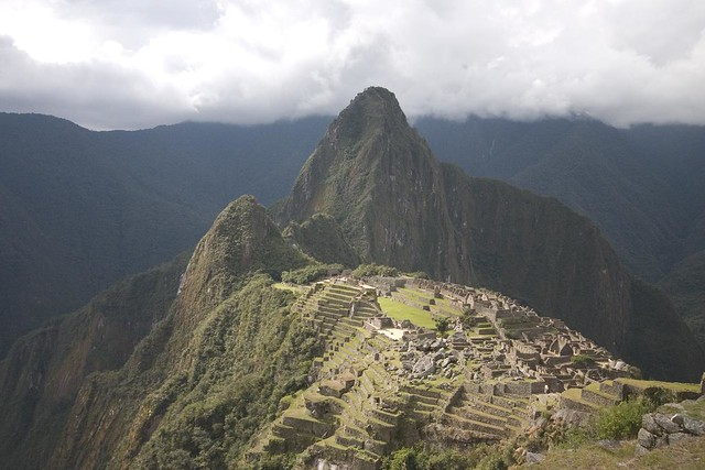 The ruins of Machu Picchu in front of the peak of Huayna Picchu